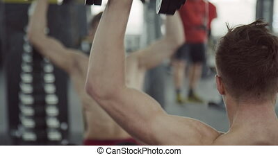 Man Doing Biceps Lifting Barbell - Croped view of atleth...