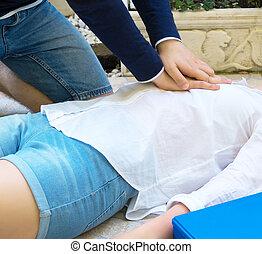 Man doing cardiopulmonary resuscitation to a woman.