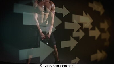 Front view of a Caucasian man doing dead lifts in the dark. Digital animation of arrows pointing in the right can be seen in the foreground