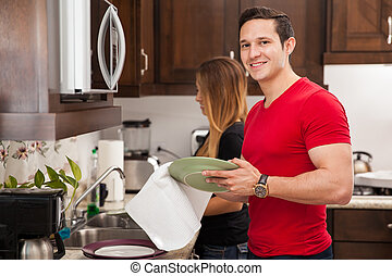 Man doing dishes with his girl