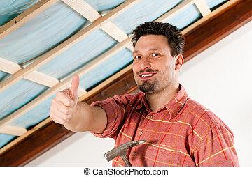 Man doing dry walling, working