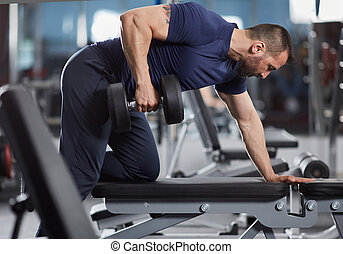 Man doing dumbbell row on bench
