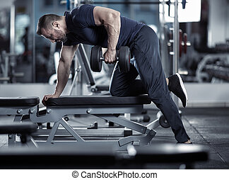 Man doing dumbbell row