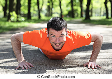 man doing exercice in a park in summer