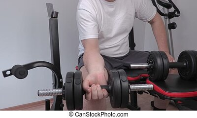 Man doing exercise with dumbbell for arms