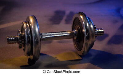 Man doing exercise with dumbbell