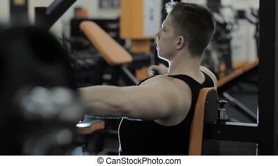 man doing exercises in the gym