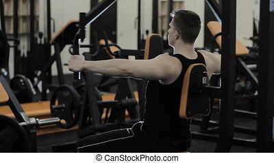 man doing exercises in the gym - Man looking in the mirror...