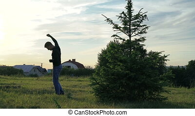 Man doing exercises on the nature. Slowly