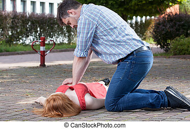 Man doing first aid on the street