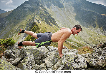 Man doing fitness on a mountain