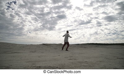 Man doing handstand - Unrecognizable man doing handstand on...