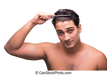 Young Man Combing His Hair With A Comb Isolated On White