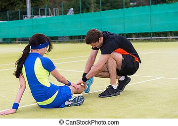 Man doing massage to his female tennis partner