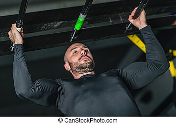 Man doing pull-ups in the gym