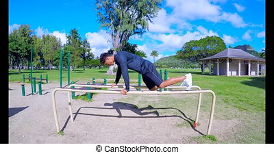 Man doing push-ups on parallel bars 4k - Man doing push-ups...