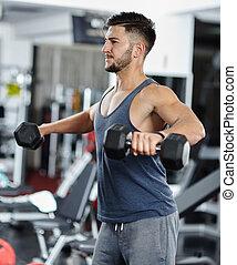 Man doing shoulder workout in a gym