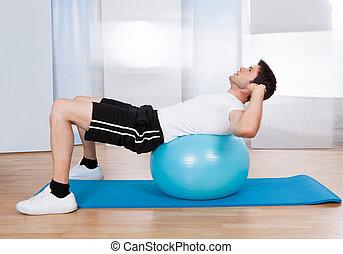 Man Doing Sit Ups On Fitness Ball