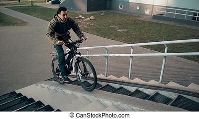 man doing trick on bicycle, ride inside the the entrance...
