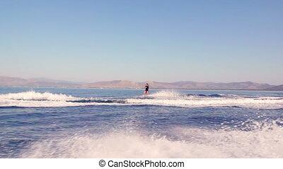 Man Doing Water Ski Tricks - Young Man Wakeboarding Jump On...