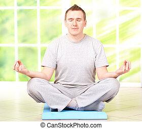 Man doing yoga exercise on mat - Portrait of man doing yoga ...