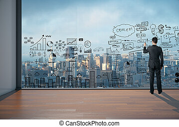 Man drawing business scheme on large window in office...