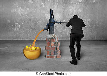 Man drawing golden sand currency symbols retro pump concrete room