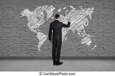 man drawing map