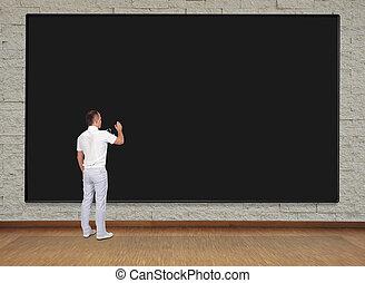 man drawing on blackboard