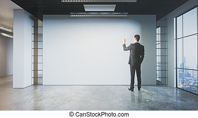 Man drawing on empty wall