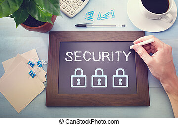 Man drawing security concept on chalkboard
