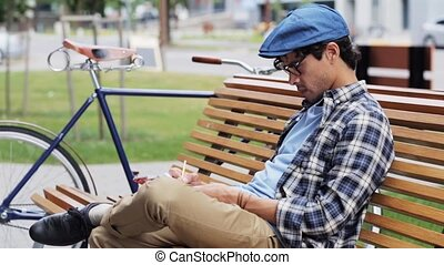 man drawing to sketchbook with pencil on street - lifestyle,...