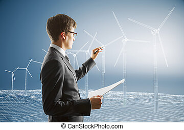 Man draws blueprint of a windmills on a blue background