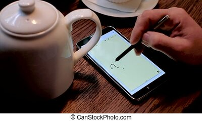 Man draws question marks on the smart phone screen