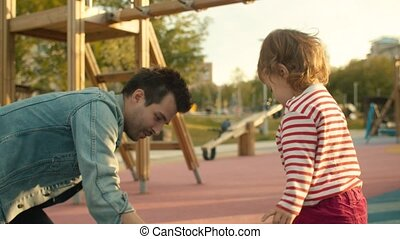 Man draws with chalks on the playground - Young man draws...