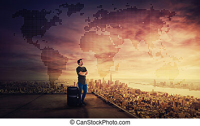 Man dreamer standing with suitcase on the rooftop of a skyscraper planning his next holiday destination