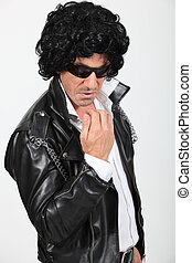 Man dressed as a rock-star
