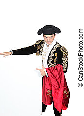 Man dressed as matador stood with blank message board