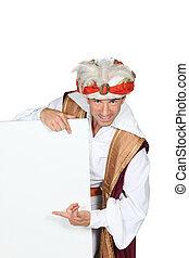 Man dressed in genie costume