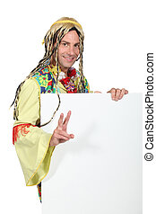 Man dressed in hippy costume