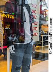 Man dressed mannequins  In Fashion Shop .