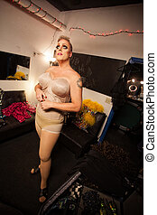 Man Dressing in Drag - Single man in foundation for drag...
