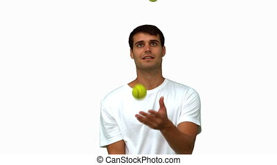 Man dribbling with tennis balls on white screen in slow...