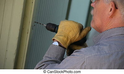man drilling a hole