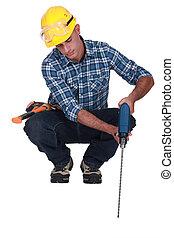 Man drilling into floor