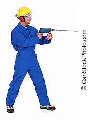 Man drilling through wall
