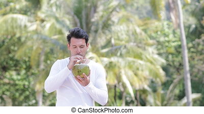 Man Drink Coconut Cocktail Over Palm Trees, Happy Smiling...