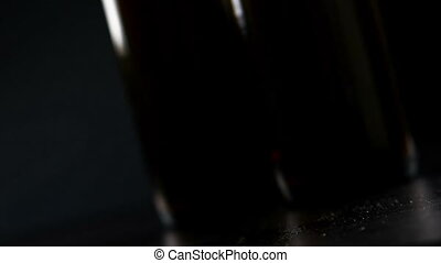 man drink fresh beer with foam in front of beer bottles background, beverage and relax concept