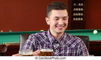 Man drinking a glass of beer