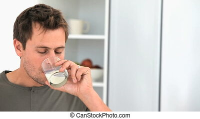 Man drinking a glass of milk